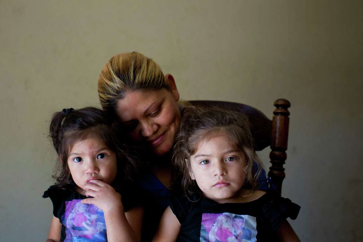 Maria Cortes is raising her daughters Denisse Brisuela, 1, left, and Keylin Brisuela, 2, without their dad, Denis Brisuela, who was killed by a robber two years ago. His homicide case was practically forgotten.