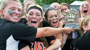 Bethlehem players celebrate their  Class AA softball final win against Columbia High Saturday May 31, 2014, in Clifton Park, NY.  (John Carl D'Annibale / Times Union)