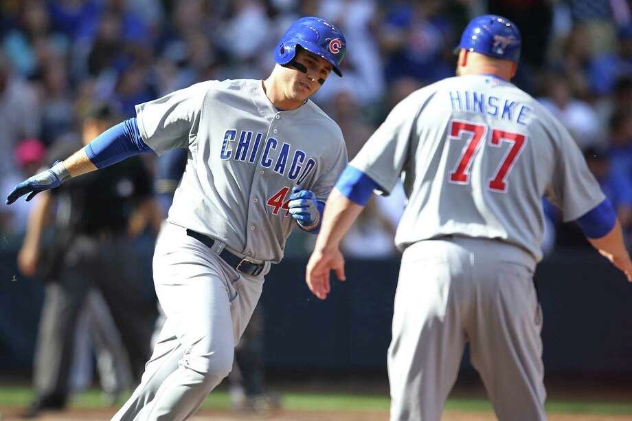 The Cubs' Anthony Rizzo, who had two two-run home runs, is congratulated by coach Eric Hinske. Photo: Mike McGinnis / Getty Images / 2014 Getty Images