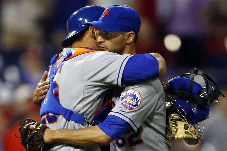 Mets catcher Anthony Recker (left) hugs pitcher Carlos Torres after New York's victory. Photo: Rich Schultz / Getty Images / 2014 Getty Images