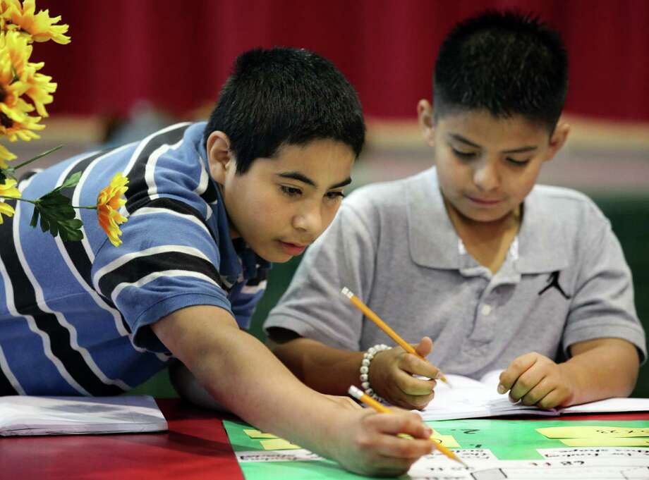 """Armando Rivera (left) and Dylan Rodriguez go through math problems at Hopkins Elementary's """"Math Dash"""" in preparation for STAAR. Photo: San Antonio Express-News / File Photo / © 2012 San Antonio Express-News"""