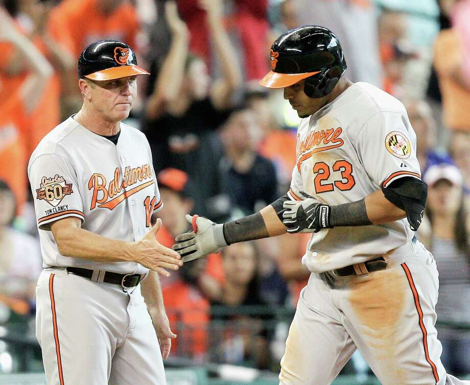 HOUSTON, TX - MAY 31:  Nelson Cruz #23 of the Baltimore Orioles is congratulated by  Bobby Dickerson #11 after homering in the eighth inning against the Houston Astros at Minute Maid Park on May 31, 2014 in Houston, Texas.  (Photo by Bob Levey/Getty Images) ORG XMIT: 477584139 Photo: Bob Levey / 2014 Getty Images