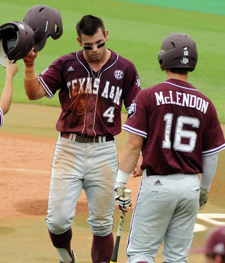 Texas A&M's Nick Banks is congratulated after scoring a run during the third inning of a victory over George Mason at Reckling Park in Houston. Photo: Eric Christian Smith / For The Houston Chronicle