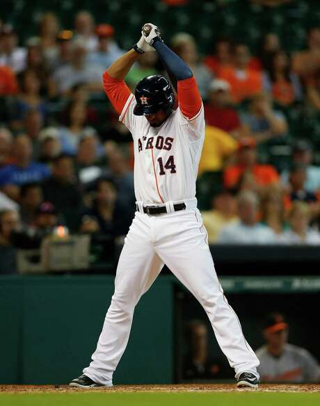 Astros first baseman Jesus Guzman strikes out in the ninth inning of the 4-1 loss to the Orioles that ended the team's seven-game winning streak. Photo: Karen Warren, Staff / © 2014 Houston Chronicle