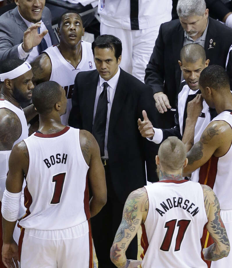 Heat coach Erik Spoelstra (center) has emphasized to his players that even though they're making NBA Finals berths appear to be automatic, each trip is not to be taken for granted. Photo: Wilfredo Lee / Associated Press / AP