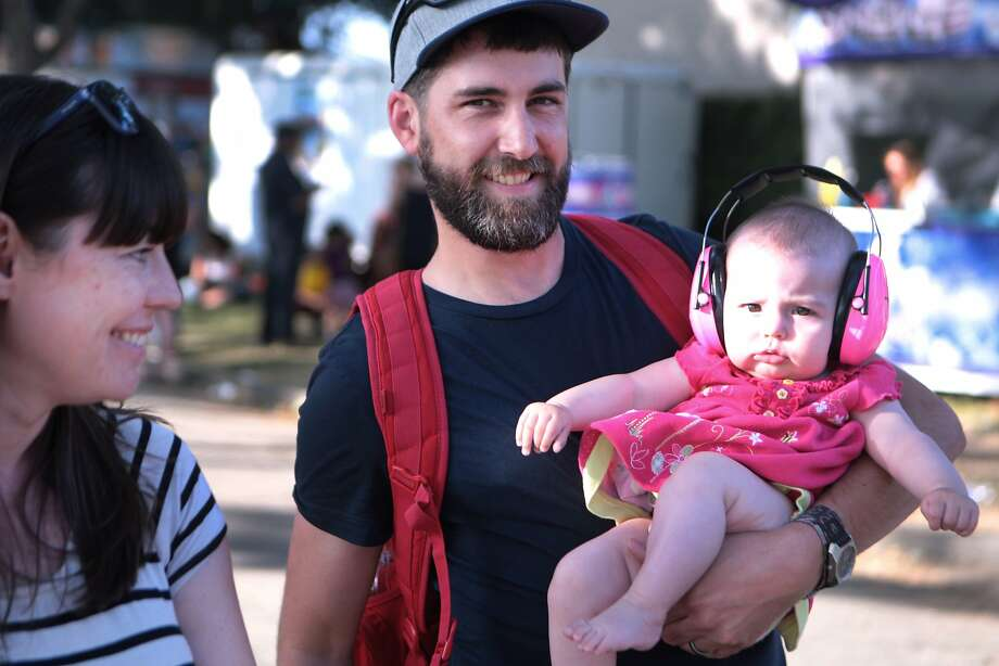 Katie McLaurin, left, and husband Andrew of Sonoma brought six-month-old daughter Rosie to her first concert at the 2014 Bottlerock Napa Valley music, food and wine festival on Saturday, May 31, 2014 in Napa, Calif. Photo: Kevin N. Hume, The Chronicle