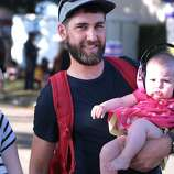 Katie McLaurin, left, and husband Andrew of Sonoma brought six-month-old daughter Rosie to her first concert at the 2014 Bottlerock Napa Valley music, food and wine festival on Saturday, May 31, 2014 in Napa, Calif.