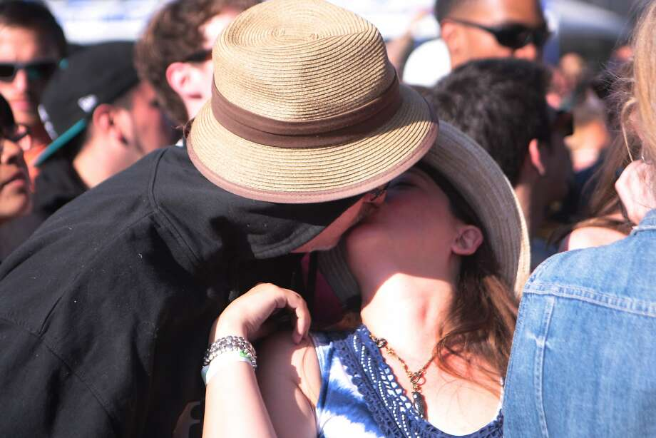 Mark Axelrod and Jennifer McCormick of Alameda share a smooch before Weezer's performance at the 2014 Bottlerock Napa Valley music, food and wine festival on Saturday, May 31, 2014 in Napa, Calif. Photo: Kevin N. Hume, The Chronicle