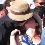 Mark Axelrod and Jennifer McCormick of Alameda share a smooch before Weezer's performance at the 2014 Bottlerock Napa Valley music, food and wine festival on Saturday, May 31, 2014 in Napa, Calif.