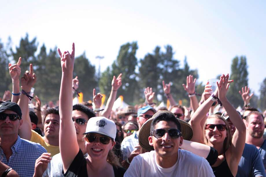 Frans hold up their hands during Third Eye Blind's set at the 2014 Bottlerock Napa Valley music, food and wine festival on Saturday, May 31, 2014 in Napa, Calif. Photo: Kevin N. Hume, The Chronicle