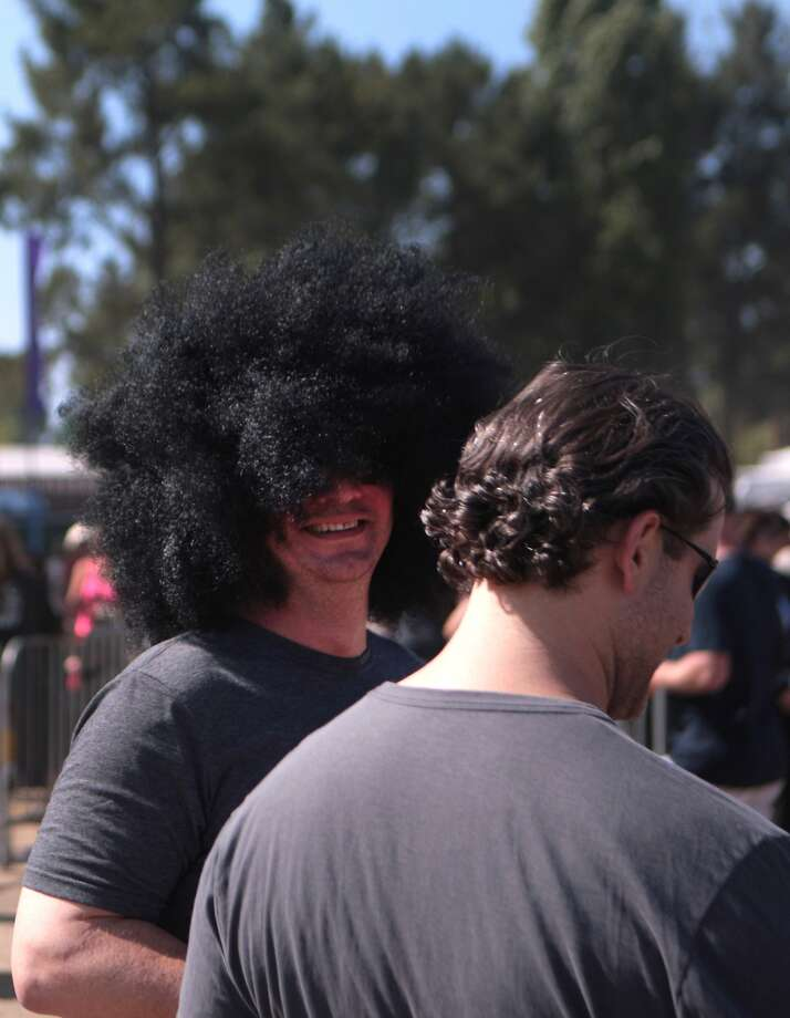 A fan sports a large afro wig at the 2014 Bottlerock Napa Valley music, food and wine festival on Saturday, May 31, 2014 in Napa, Calif. Photo: Kevin N. Hume, The Chronicle