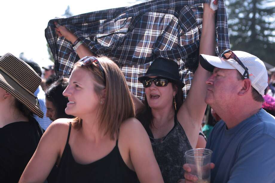 Jasmin Noland, left, and John Noland, right, are shaded by Zorina Noland during Third Eye Blind's set at the 2014 Bottlerock Napa Valley music, food and wine festival on Saturday, May 31, 2014 in Napa, Calif. Photo: Kevin N. Hume, The Chronicle
