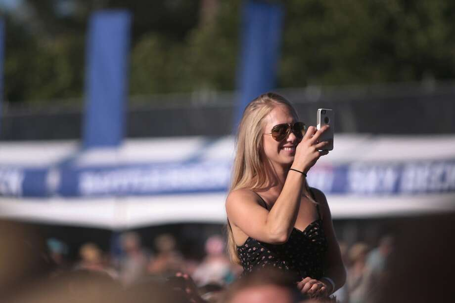 A fan snaps some photos while on someone's shoulders at the 2014 Bottlerock Napa Valley music, food and wine festival on Saturday, May 31, 2014 in Napa, Calif. Photo: Kevin N. Hume, The Chronicle