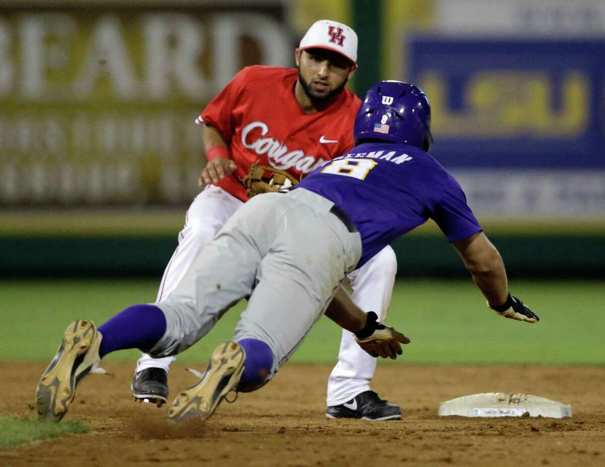 LSU's Alex Bregman (8) is caught stealing second base by Houston infielder Frankie Ratcliff to end the ninth inning of an NCAA college baseball regional tournament game in Baton Rouge, La., Saturday, May 31, 2014. LSU won 5-1. (AP Photo/Gerald Herbert)