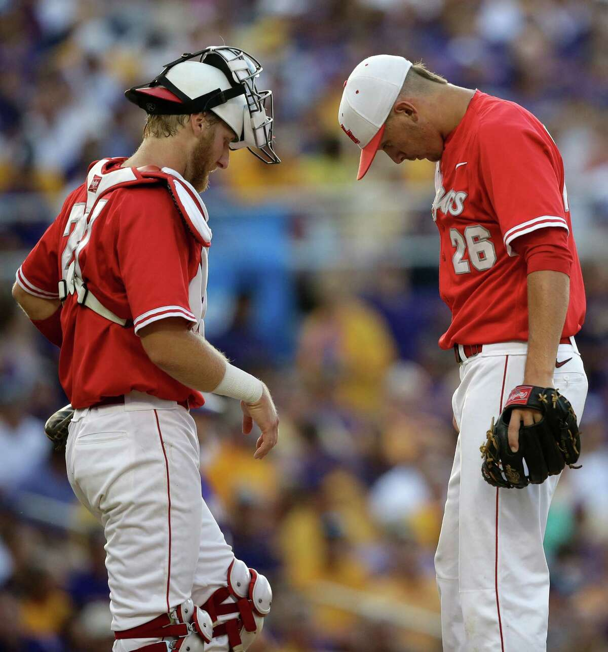Houston catcher Caleb Barker talks on the mound with pitcher Jake Lemoine (26) in the second inning of an NCAA college baseball regional tournament game in Baton Rouge, La., Saturday, May 31, 2014. (AP Photo/Gerald Herbert)