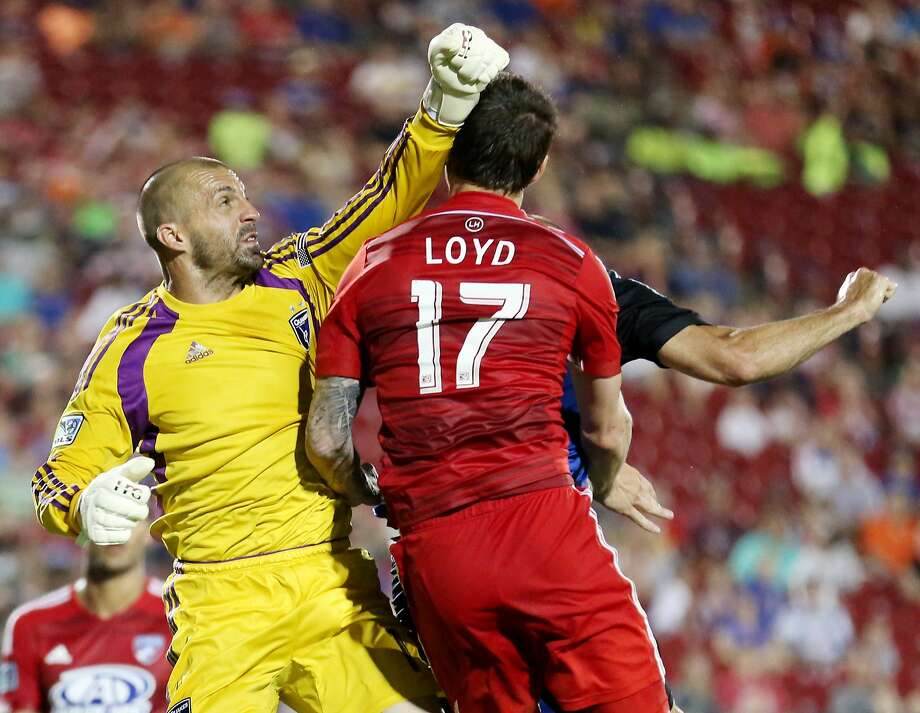 Earthquakes goalkeeper Jon Busch and FC Dallas' Zack Loyd compete for the ball during the second half. Photo: Andy Jacobsohn, Associated Press