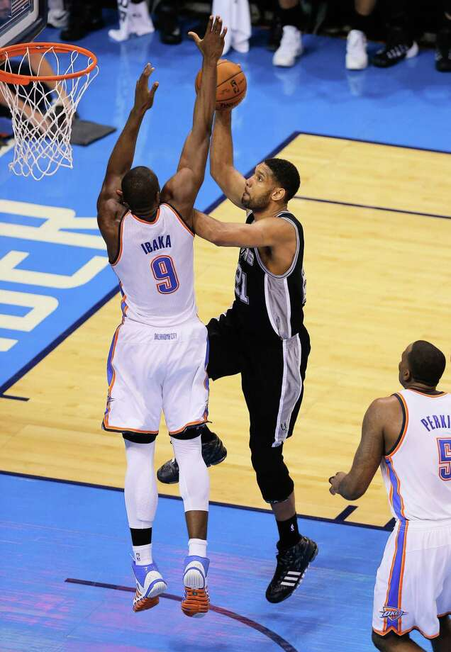 OKLAHOMA CITY, OK - MAY 31:  Tim Duncan #21 of  of the San Antonio Spurs shoots over Serge Ibaka #9 of the Oklahoma City Thunder in the second half during Game Six of the Western Conference Finals of the 2014 NBA Playoffs at Chesapeake Energy Arena on May 31, 2014 in Oklahoma City, Oklahoma. NOTE TO USER: User expressly acknowledges and agrees that, by downloading and or using this photograph, User is consenting to the terms and conditions of the Getty Images License Agreement.  (Photo by Tom Pennington/Getty Images) ORG XMIT: 491979719 Photo: Tom Pennington / 2014 Getty Images