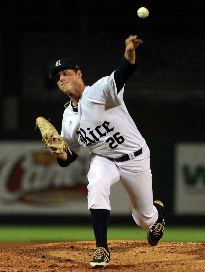 Rice's Blake Fox delivers a pitch during the first inning of a Houston NCAA baseball regional game against Texas, Saturday, May 31, 2014, at Reckling Park in Houston. Photo: Eric Christian Smith, For The Chronicle