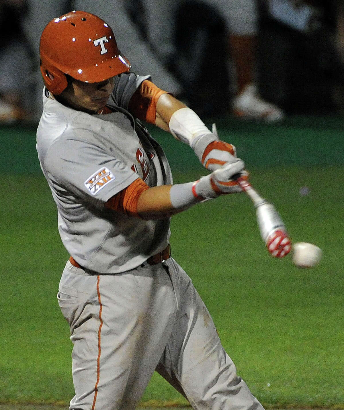 Texas' Madison Carter connects and reaches first on a fielder's choice during the second inning of a Houston NCAA baseball regional game against Rice, Saturday, May 31, 2014, at Reckling Park in Houston.