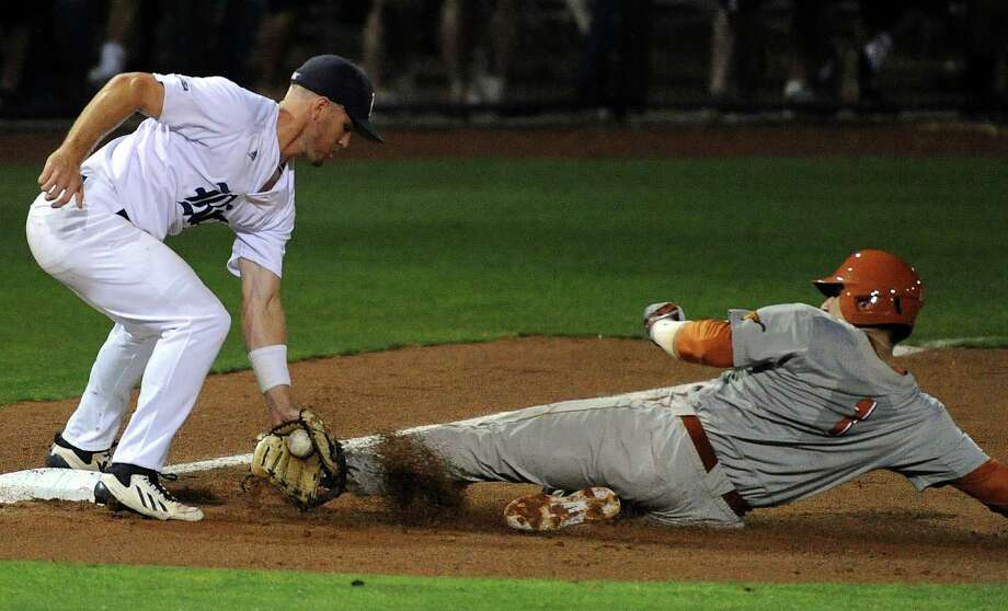Rice's Shane Hoelscher, left, tags out Texas' Tres Barrera at third base during the second inning of a Houston NCAA baseball regional game, Saturday, May 31, 2014, at Reckling Park in Houston. Photo: Eric Christian Smith, For The Chronicle