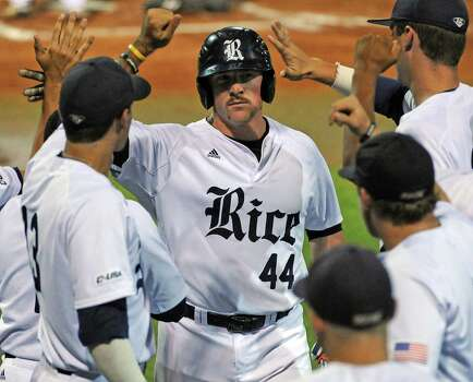 Rice's Skyler Ewing (44) celebrates scoring the Owls first run of the game with teammates during the second inning of a Houston NCAA baseball regional game against Texas, Saturday, May 31, 2014, at Reckling Park in Houston. Photo: Eric Christian Smith, For The Chronicle
