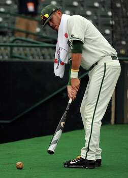 George Mason's Andrew Sable putts a baseball near the Patriots' dugout during a weather delay before a Houston NCAA baseball regional game against Texas A&M, Saturday, May 31, 2014, at Reckling Park in Houston. Photo: Eric Christian Smith, For The Chronicle