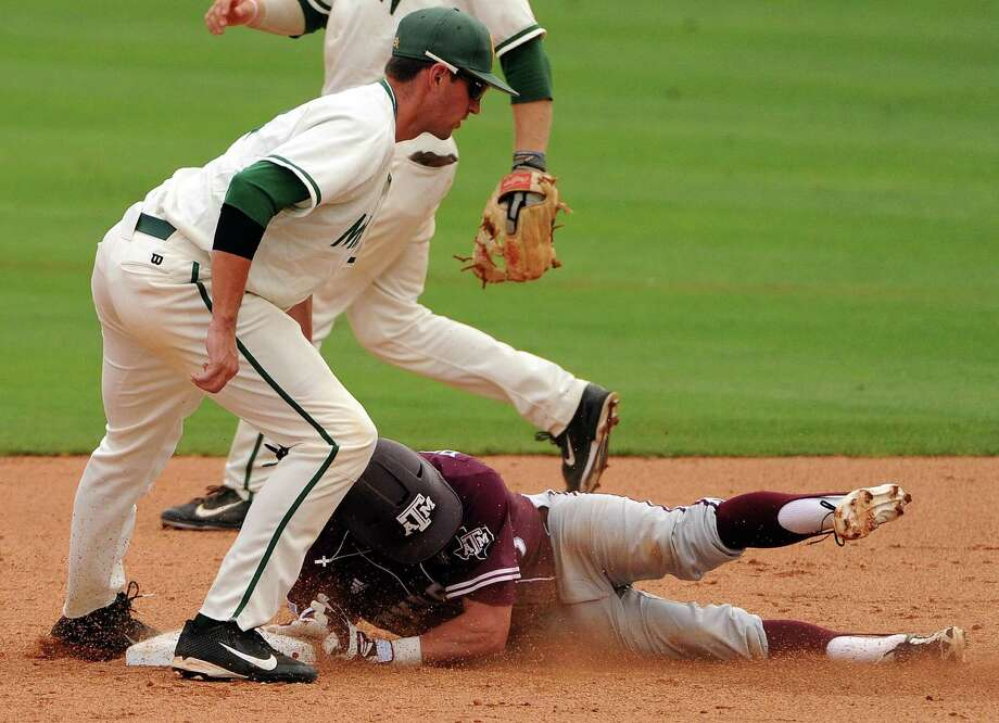 Texas A&M's Nick Banks, right, is tagged out by George Mason's Chris Cook while attempting a steal attempt of second base during the third inning of a Houston NCAA baseball regional game, Saturday, May 31, 2014, at Reckling Park in Houston. Photo: Eric Christian Smith, For The Chronicle