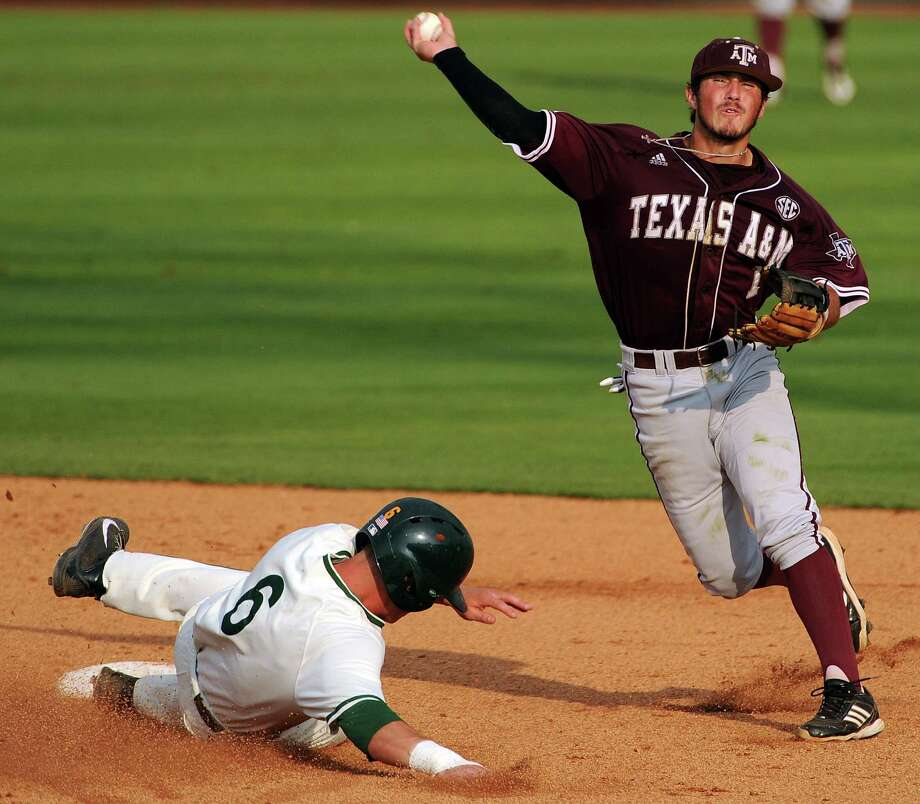 Texas A&M's Blake Allemand, right, throws to first a after forcing out George Mason's Mick Foley during the sixth inning of an NCAA college baseball tournament regional game, Saturday, May 31, 2014, at Reckling Park in Houston. (AP Photo/The Houston Chronicle, Eric Christian Smith) MANDATORY CREDIT Photo: Eric Christian Smith, Associated Press / Houston Chronicle