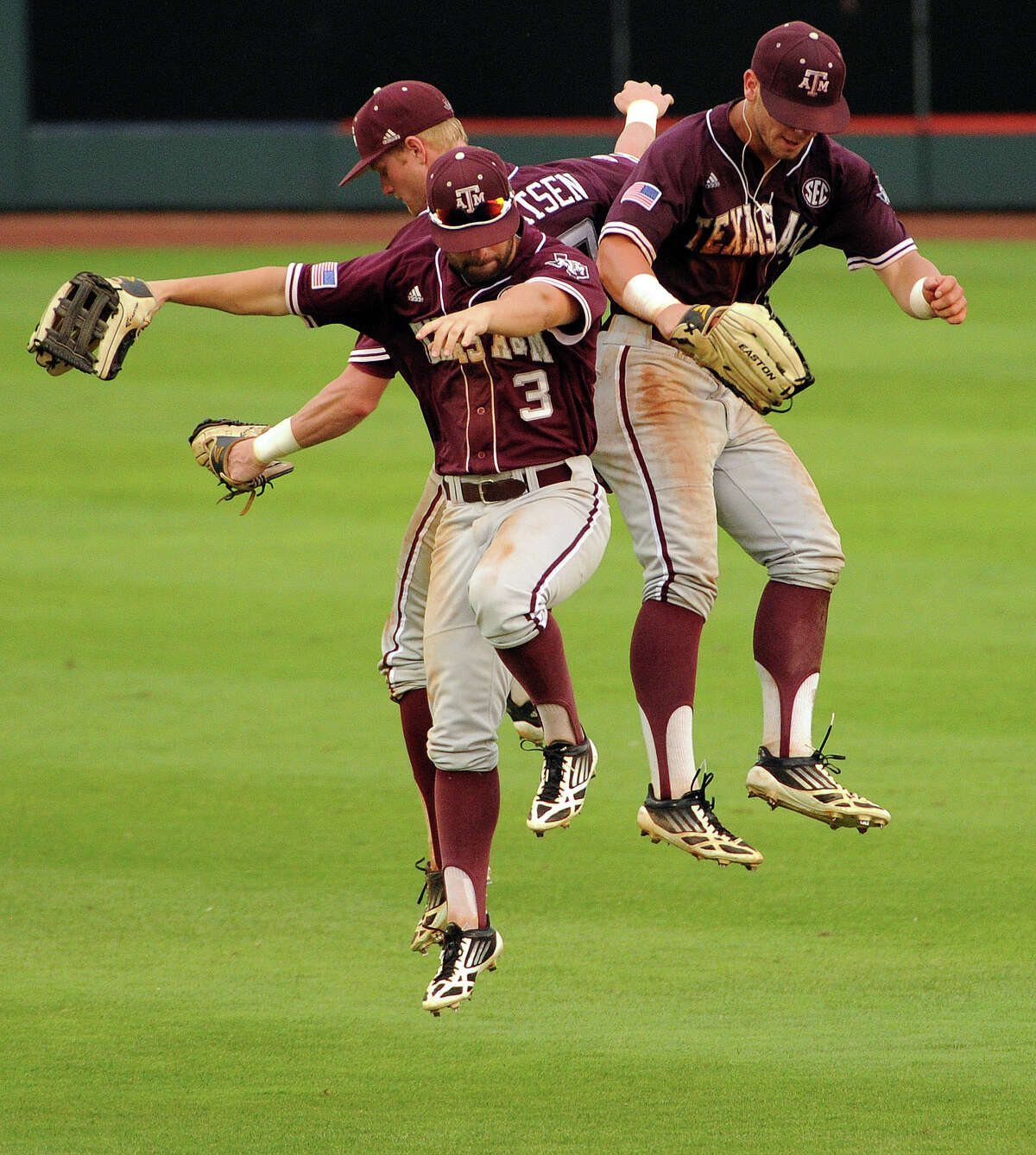 Texas A&M outfielders Jace Statum,front left, Krey Bratsen and Nick Banks, right, celebrate the Aggies' 7-3 victory over George Mason in an NCAA college baseball tournament regional game, Saturday, May 31, 2014, at Reckling Park in Houston. (AP Photo/Houston Chronicle, Eric Christian Smith) MANDATORY CREDIT