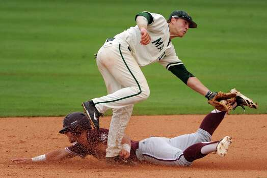 Texas A&M's Nick Banks steals second base as George Mason's Chris Cook defends during the third inning of an NCAA college baseball tournament regional game, Saturday, May 31, 2014, at Reckling Park in Houston. (AP Photo/Houston Chronicle, Eric Christian Smith) MANDATORY CREDIT Photo: Eric Christian Smith, Associated Press / Houston Chronicle