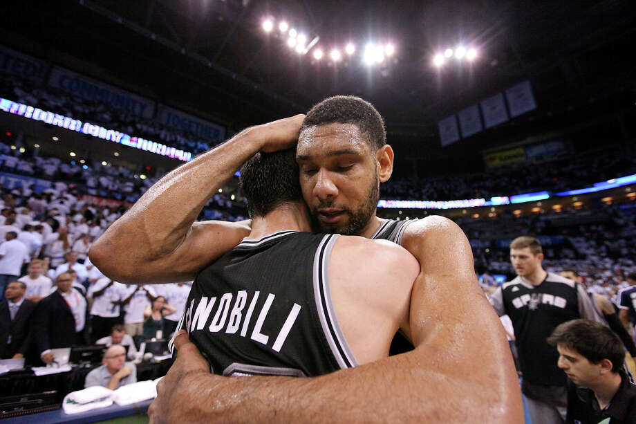San Antonio Spurs' Manu Ginobili and Tim Duncan celebrate after Game 6 of the Western Conference finals Saturday May 31, 2014 at Chesapeake Energy Arena in Oklahoma City, OK. The Spurs won 112-107 and advance to the NBA Finals to play the Miami Heat. Photo: Edward A. Ornelas, Staff  / © 2014 San Antonio Express-News