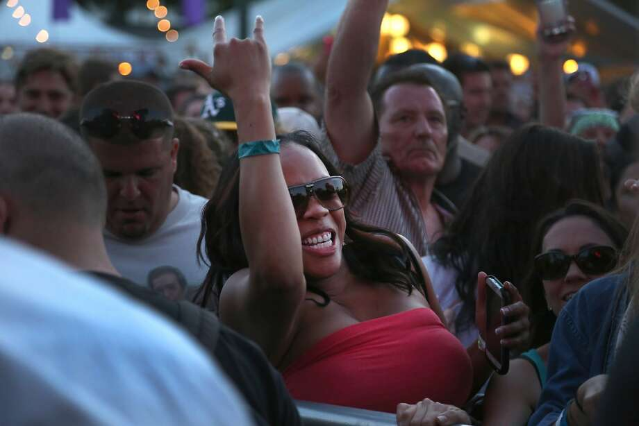 A fan gestures during Outkast's performance at the 2014 Bottlerock Napa Valley music, food and wine festival on Saturday, May 31, 2014 in Napa, Calif. Photo: Kevin N. Hume, The Chronicle