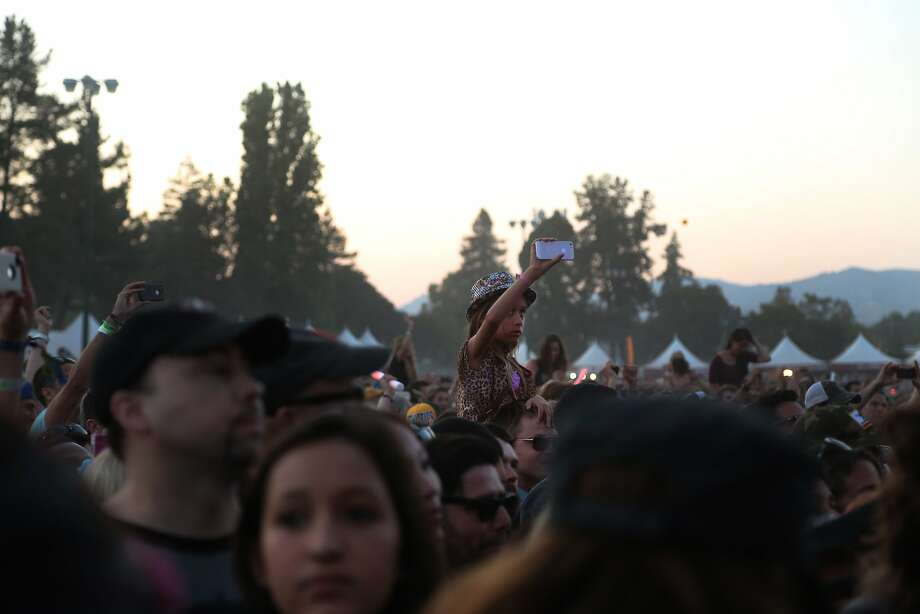 A young girl rests on someone's shoulders and takes video of Outkast's performance at the 2014 Bottlerock Napa Valley music, food and wine festival on Saturday, May 31, 2014 in Napa, Calif. Photo: Kevin N. Hume, The Chronicle
