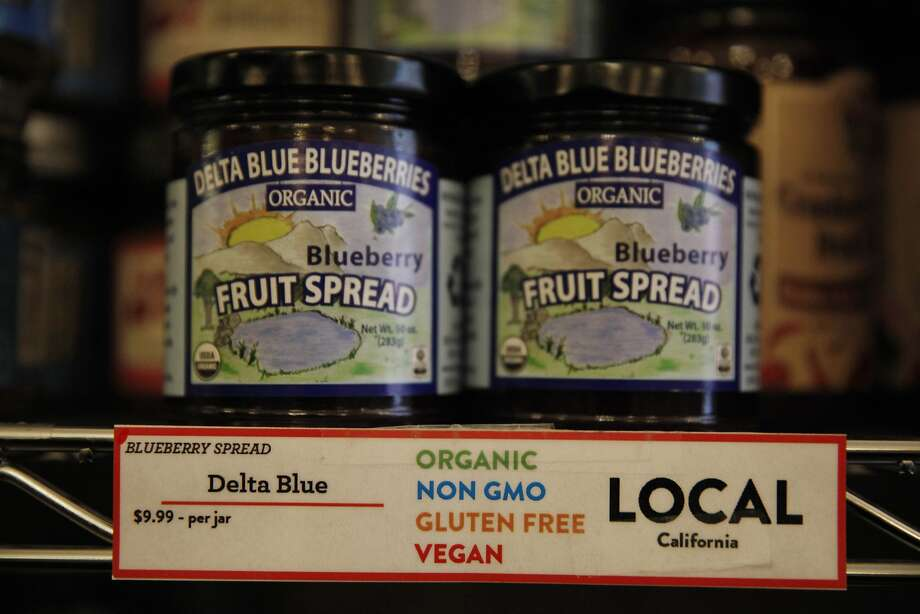 Labels that identify blackberry fruit spread made without genetically modified organisms are currently voluntary; a Senate bill would ban any state laws requiring mandatory GMO labeling.  Photo: Lea Suzuki, The Chronicle