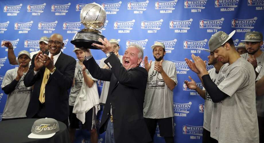 San Antonio Spurs owner Peter Holt and the team celebrates with the trophy after Game 6 of the Western Conference finals against the Oklahoma City Thunder Saturday May 31, 2014 at Chesapeake Energy Arena in Oklahoma City, OK. The Spurs won 112-107 and advance to the NBA Finals to play the Miami Heat. Photo: Edward A. Ornelas, San Antonio Express-News