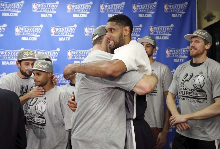 San Antonio Spurs' Aron Baynes and Tim Duncan celebrate with the team after Game 6 of the Western Conference finals against the Oklahoma City Thunder Saturday May 31, 2014 at Chesapeake Energy Arena in Oklahoma City, OK. The Spurs won 112-107 and advance to the NBA Finals to play the Miami Heat. Photo: Edward A. Ornelas, San Antonio Express-News