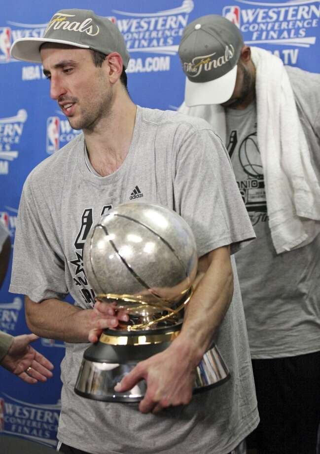 San Antonio Spurs' Manu Ginobili holds the trophy after Game 6 of the Western Conference finals against the Oklahoma City Thunder Saturday May 31, 2014 at Chesapeake Energy Arena in Oklahoma City, OK. The Spurs won 112-107 and advance to the NBA Finals to play the Miami Heat. Photo: Edward A. Ornelas, San Antonio Express-News