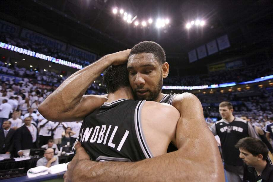 San Antonio Spurs' Manu Ginobili and Tim Duncan celebrate after Game 6 of the Western Conference finals Saturday May 31, 2014 at Chesapeake Energy Arena in Oklahoma City, OK. The Spurs won 112-107 and advance to the NBA Finals to play the Miami Heat. Photo: Edward A. Ornelas, San Antonio Express-News