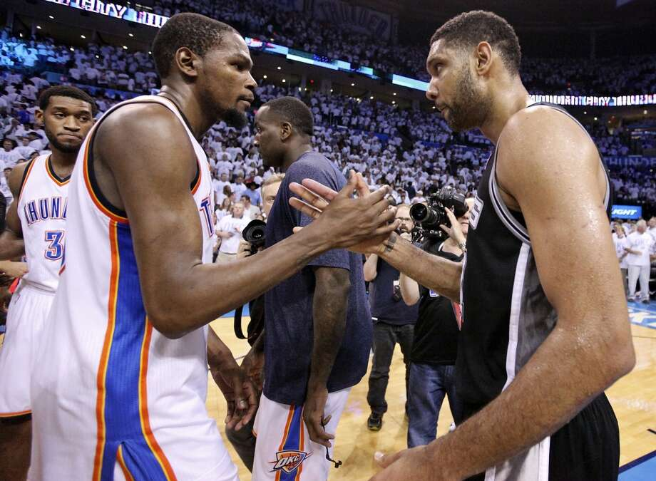 Oklahoma City Thunder's Kevin Durant and San Antonio Spurs' Tim Duncan shake hands after Game 6 of the Western Conference finals Saturday May 31, 2014 at Chesapeake Energy Arena in Oklahoma City, OK. The Spurs won 112-107 and advance to the NBA Finals to play the Miami Heat. Photo: Edward A. Ornelas, San Antonio Express-News