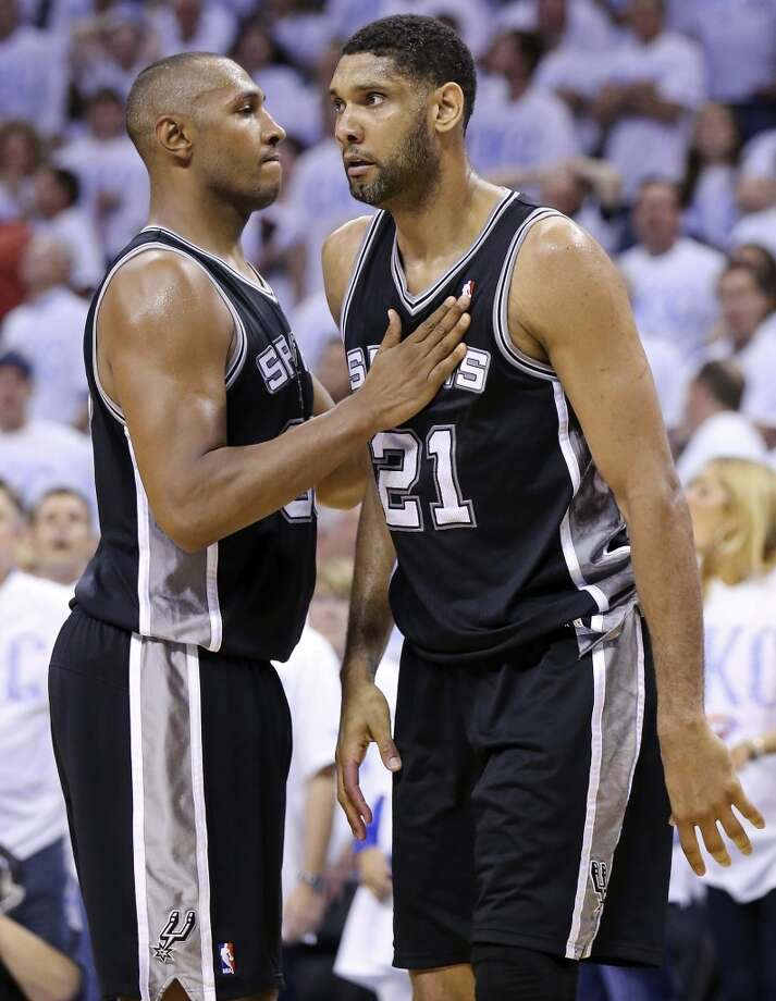 San Antonio Spurs' Boris Diaw and Tim Duncan react after a play during overtime action in Game 6 of the Western Conference finals against the Oklahoma City Thunder Saturday May 31, 2014 at Chesapeake Energy Arena in Oklahoma City, OK. The Spurs won 112-107 and advance to the NBA Finals to play the Miami Heat. Photo: Edward A. Ornelas, San Antonio Express-News
