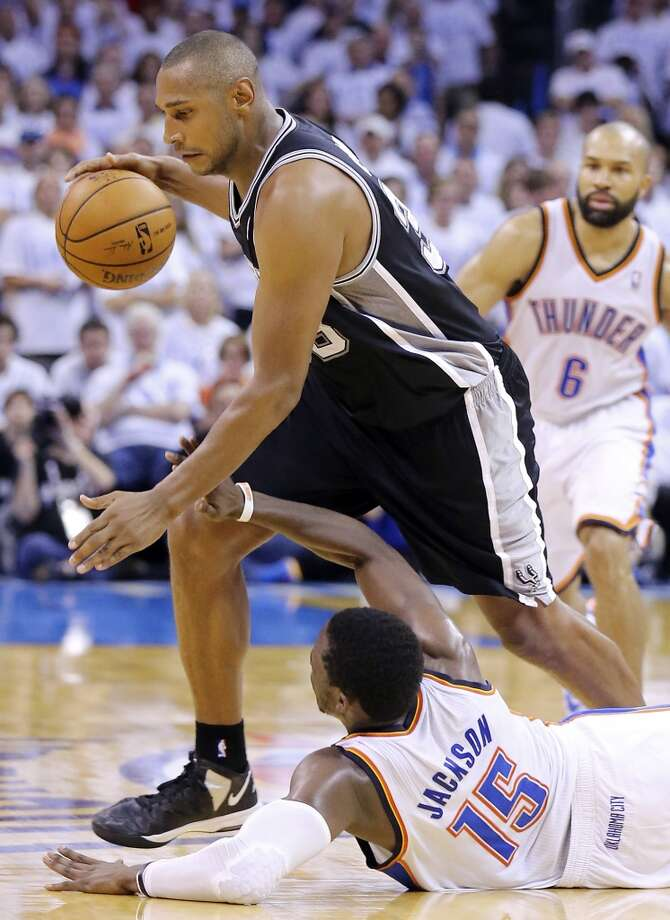 San Antonio Spurs' Boris Diaw looks for room over Oklahoma City Thunder's Reggie Jackson during overtime action in Game 6 of the Western Conference finals Saturday May 31, 2014 at Chesapeake Energy Arena in Oklahoma City, OK. The Spurs won 112-107 and advance to the NBA Finals to play the Miami Heat. Photo: Edward A. Ornelas, San Antonio Express-News