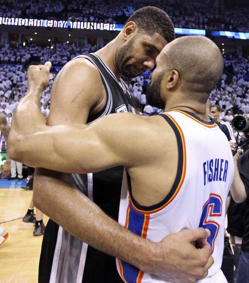 San Antonio Spurs' Tim Duncan and Oklahoma City Thunder's Derek Fisher talk after Game 6 of the Western Conference finals Saturday May 31, 2014 at Chesapeake Energy Arena in Oklahoma City, OK. The Spurs won 112-107 and advance to the NBA Finals to play the Miami Heat. Photo: Edward A. Ornelas, San Antonio Express-News