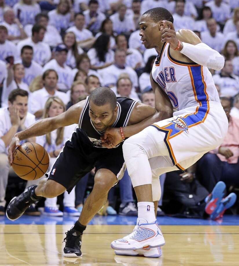 San Antonio Spurs' Tony Parker looks for room around Oklahoma City Thunder's Russell Westbrook during first half action in Game 6 of the Western Conference finals Saturday May 31, 2014 at Chesapeake Energy Arena in Oklahoma City, OK. Photo: Edward A. Ornelas, San Antonio Express-News
