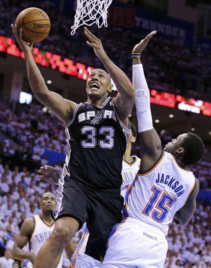 San Antonio Spurs' Boris Diaw shoots around Oklahoma City Thunder's Reggie Jackson during first half action in Game 6 of the Western Conference finals Saturday May 31, 2014 at Chesapeake Energy Arena in Oklahoma City, OK. Photo: Edward A. Ornelas, San Antonio Express-News