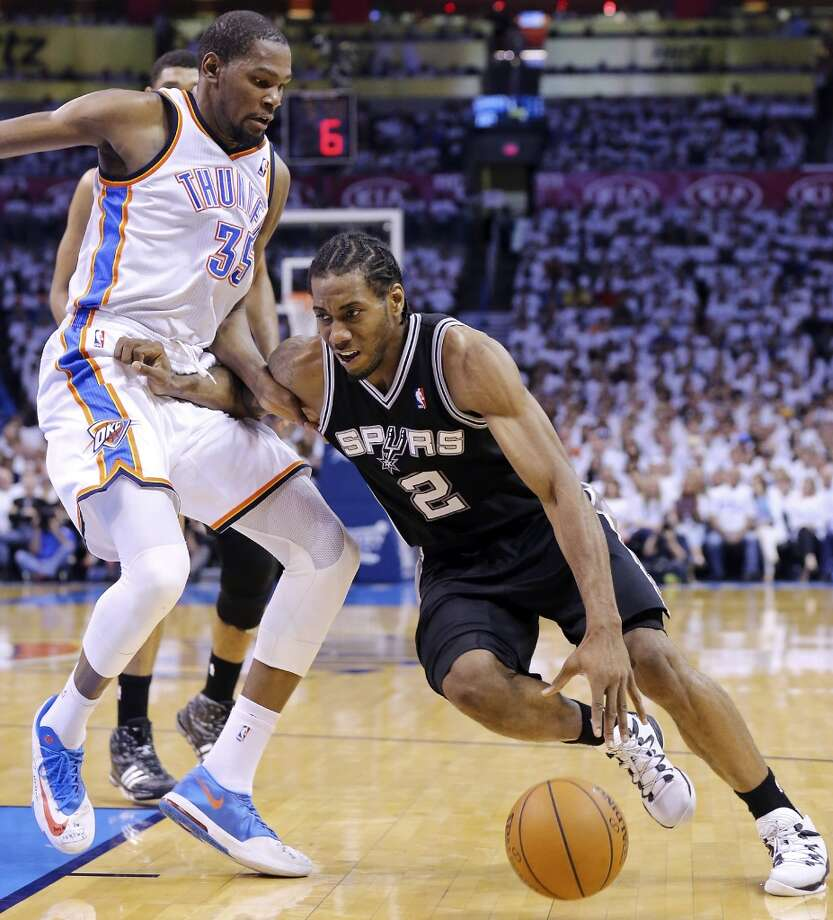 San Antonio Spurs' Kawhi Leonard looks for room around Oklahoma City Thunder's Kevin Durant during first half action in Game 6 of the Western Conference finals Saturday May 31, 2014 at Chesapeake Energy Arena in Oklahoma City, OK. Photo: Edward A. Ornelas, San Antonio Express-News