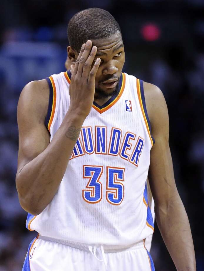 Oklahoma City Thunder's Kevin Durant reacts after a play during first half action in Game 6 of the Western Conference finals against the San Antonio Spurs Saturday May 31, 2014 at Chesapeake Energy Arena in Oklahoma City, OK. Photo: Edward A. Ornelas, San Antonio Express-News