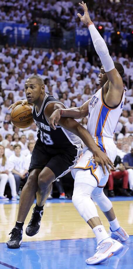 San Antonio Spurs' Boris Diaw looks for room around Oklahoma City Thunder's Russell Westbrook during first half action in Game 6 of the Western Conference finals Saturday May 31, 2014 at Chesapeake Energy Arena in Oklahoma City, OK. Photo: Edward A. Ornelas, San Antonio Express-News