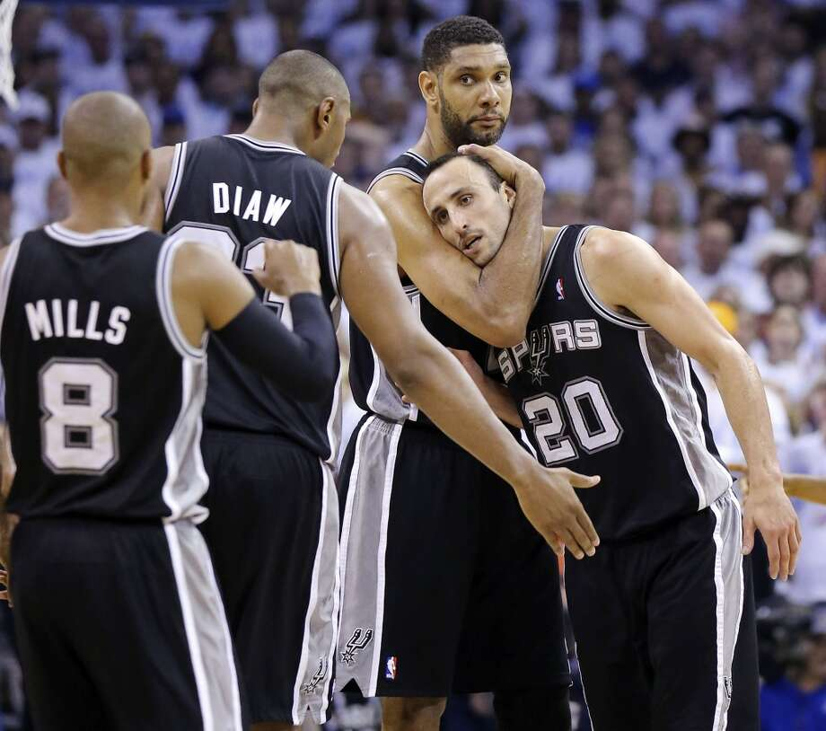 San Antonio Spurs' Tim Duncan and Manu Ginobili hug after Ginobili scored late in second half action in Game 6 of the Western Conference finals against the Oklahoma City Thunder Saturday May 31, 2014 at Chesapeake Energy Arena in Oklahoma City, OK. The Spurs won 112-107 and advance to the NBA Finals to play the Miami Heat. Photo: Edward A. Ornelas, San Antonio Express-News