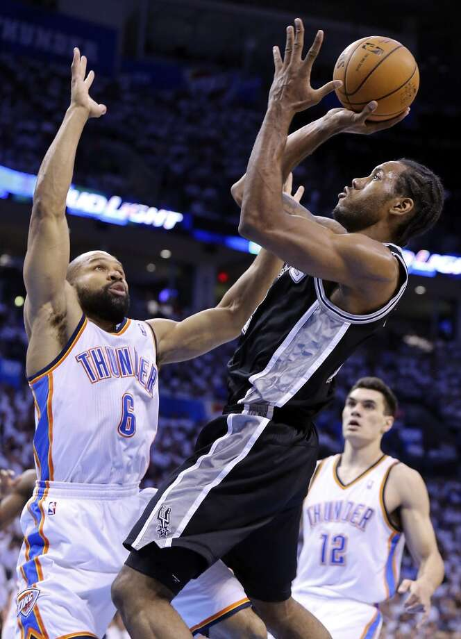 San Antonio Spurs' Kawhi Leonard shoots over Oklahoma City Thunder's Derek Fisher during first half action in Game 6 of the Western Conference finals Saturday May 31, 2014 at Chesapeake Energy Arena in Oklahoma City, OK. Photo: Edward A. Ornelas, San Antonio Express-News