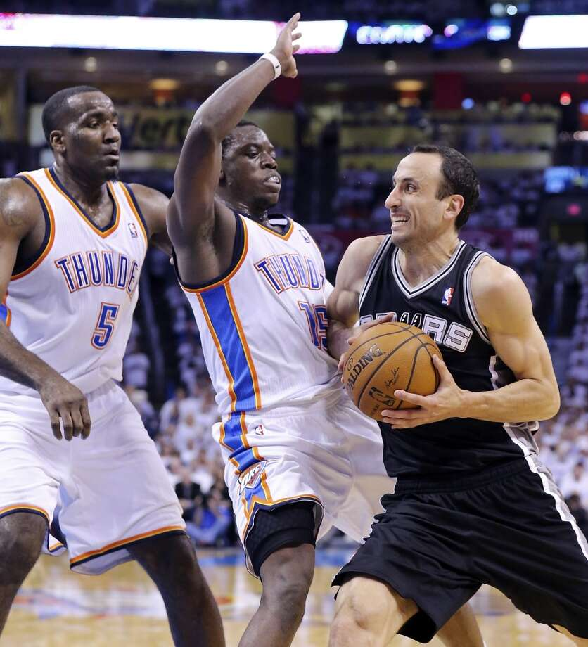 San Antonio Spurs' Manu Ginobili looks for room around Oklahoma City Thunder's Kendrick Perkins (left) and Reggie Jackson during first half action in Game 6 of the Western Conference finals Saturday May 31, 2014 at Chesapeake Energy Arena in Oklahoma City, OK. Photo: Edward A. Ornelas, San Antonio Express-News